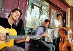 Parisians playing American jazz under the arcades of Place des Vosges in Paris' Marais.