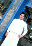 Baker, in front of a rue des Rosiers bakery, in the Jewish district of Paris' Marais.