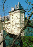 Compact and massive, the 14C Chateau de Saumur has a graceful thrust to the vertical lines of its towers.