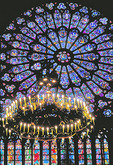 Rose window and chandelier in Notre Dame Cathdral.