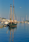 Camden Harbor, in summer, is a base for historic windjammers that offer sailing excursions along Maine's Penobscot Bay.
