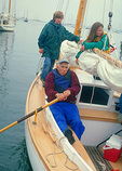 A Friendship Society Sloop glides into Rockland Harbor, guided by a grandfather and his two grandchildren, after a day of sailing in Penobscot Bay.