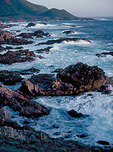 Surf and coastline of Point Lobos State Reserve, at sunset, in the scenic Monterey Peninsula.