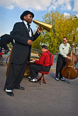 On Pont Saint-Louis, I photographed three musicians playing Dixieland jazz, just as a bicyclist in red socks came whizzing by.
