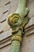 If you walk on the Quai d'Anjou, on Ile St-Louis, you'll see gilded drainpipes in the shape of a fish, belonging to the Hotel de Lauzun, where Baudelaire, the poet, once lived.