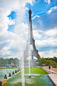 The Eiffel Tower and Trocadero Fountains under a dramatic daytime sky.
