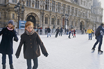 Skating at the Hôtel de Ville's ice rink is a winter treat for these two young Parisians.