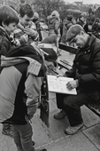 A Paris sketch artist attracts the rapt attention of three young boys on winter holiday.