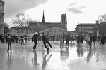 Reflections of skaters on the ice rink of Paris' Hôtel de Ville.