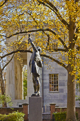 "Statue of ""The Signer, which commemorates the signing of both the Declaration of Independence and the Constitution of the United States, in an autumnal setting outside Independence Hall."