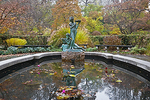 "The Burnett Fountain with sculpture of a young boy and girl representing characters from Frances Hodgson Burnett's ""Secret Garden,"" evokes the Victorian era, in the autumnal setting of Central Park's Conservatory Garden."