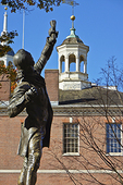 "The statue of ""The Signer,"" which commemorates the signers of both the Declaration of Independence and the Constitutiion of the United States, looks toward Independence Hall."