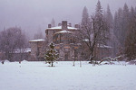 Snow-covered gables of Ahwahnee Hotel, in lightly falling snow, as seen from the south meadow.