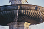 Basin of Aix's La Rotunde Fountain in the late afternoon.