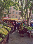 "In the food market, the Aix smell is the ""best air"" breathed with its ""stalls filled with sweet fresh vegetables."""