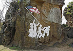 Carved replica of the Flag Raising on Iwo Jima photograph taken by Joe Rosenthal. Replica carved by U.S. Serviceman stationed on Iwo Jima after WWII.