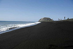 The Black Sands of Iwo Jima looking south toward Mt. Surbachi the site of the famous flag rasing photographed by Joe Rosenthal on 23 Feb 1945.