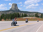Motorcycle riders from the Sturgis Motorcycle Rally ride past Devils Tower in wyoming.