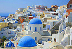 Blue domed churches dot the Greek village of Oia on the Island of Santorini.