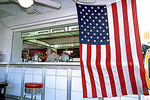 Hamburger stand and American flag in South Beach, Fl.