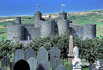 A cemetery overlooks Harlick Castle in Wales.
