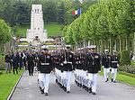 U.S. Marines march from the Aisne_Marne American Cemetery during Memorial Day celebrations at Belleau Wood battlefield in France to the town of Belleau.