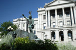 A sculpture of a Native American and a bison adorn the east grounds of the Colorado State Capitol in downtown Denver.