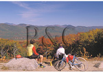 Bikers rest beside Bear Notch Road, White Mountains, New Hampshire