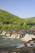 Man and Dog Fishing at Sandstone Falls, New River Gorge National River, West Virginia