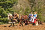 Farmer with daughter and draft horses plowing field at Spring Planting Festival, Lora Blevins Homesite, Bandy Creek Area, Big South Fork National River and Recreation Area, Oneida, TN