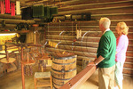 Tourists in candle maker's cabin, Fort Boonesborough State Park, Richmond, Kentucky