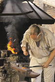 Blacksmith pounds iron at Fort Boonesborough State Park, Richmond, Kentucky