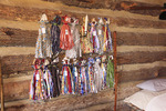Handcrafted pioneer dolls hang on cabin wall at Old Fort Harrod State Park, Harrodsburg, Kentucky