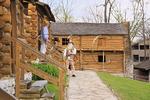 Costumed interpreters converse at Old Fort Harrod State Park, Harrodsburg, Kentucky