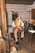 Woodworker uses an early jigsaw at Old Fort Harrod State Park, Harrodsburg, Kentucky