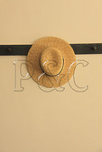 Straw Hat hung on wall of Centre Family Dwelling at Shaker Village of Pleasant Hill, Harrodsburg, Kentucky