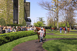 Spectators watch thoroughbreds warm up in paddock before a race at Keeneland Race Course, Lexington, Kentucky