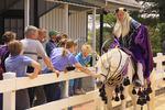 Rider and horse in Arabian costume greet children during Parade of Breeds, Kentucky Horse Park, Lexington, Kentucky