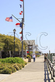 Visitors stroll on boardwalk in Beaufort, North Carolina, USA