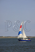 Sailboat passes through Beaufort Inlet at Fort Macon State Park, Atlantic Beach, North Carolina, USA