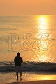 A fisherman surf fishes at sunrise, Kitty Hawk Beach, North Carolina, USA