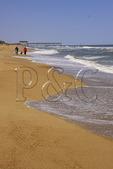 Family walking on the beach at Kitty Hawk, North Carolina, USA