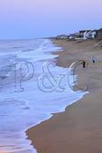 People strolling on the beach at sunset, Kitty Hawk, North Carolina, USA