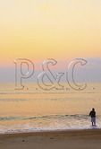 A surf fisherman at sunrise, Kitty Hawk, North Carolina, USA