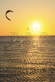 Kiteboarding at sunset on Pimlico Sound near Canadian Hole, Cape Hatteras National Seashore, Outer Banks, Buxton, North Carolina, USA