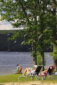 A family enjoys the beach at Silver Tree Marina on Deep Creek Lake, Thayerville, Maryland, USA