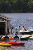 Boaters fill up with gas at Silver Tree Marina on Deep Creek Lake, Thayerville, Maryland, USA
