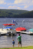 Father and son look at the boats at Silver Tree Marina on Deep Creek Lake, Thayerville, Maryland, USA