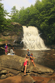 Family playing in river at Muddy Creek Falls, Swallow Falls State Park, Oakland, Maryland, USA