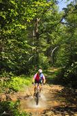 Mountain biker crossing stream in George Washington National Forest near Dayton, Virginia, USA